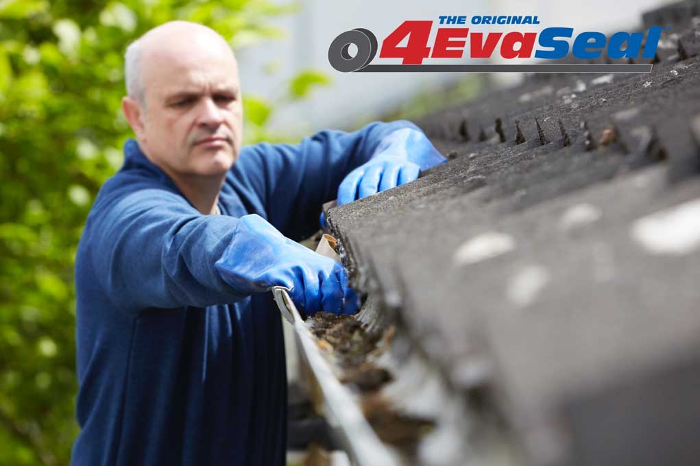 Person Cleaning Gutters Before Applying 4EvaSeal Sealant Products