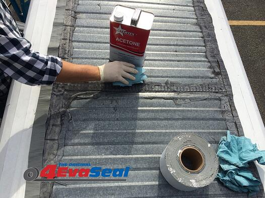 Cleaning surface to apply 4EvaSeal tape to prevent leaks in metal roofs