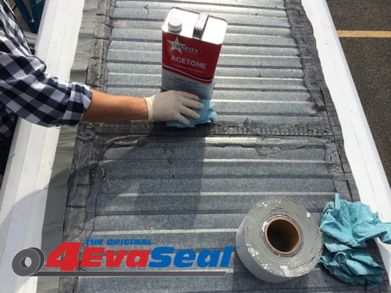 Cleaning metal roof surface