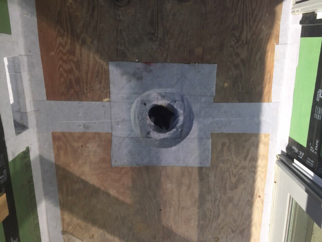 Reinforcing tape over drain, seams and scupper