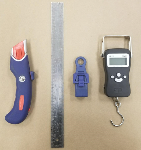 Utility knife and elements to test a waterproofing tape bond.png